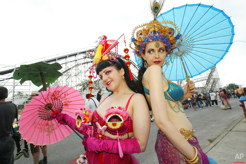 Kate Higgins, left, and Jennie Fiske, dressed as goddesses of the sea, pose at the 22nd Annual Mermaid Parade in the Coney Island section of New York Saturday, June 26, 2004. (AP Photo/Joe Kohen)