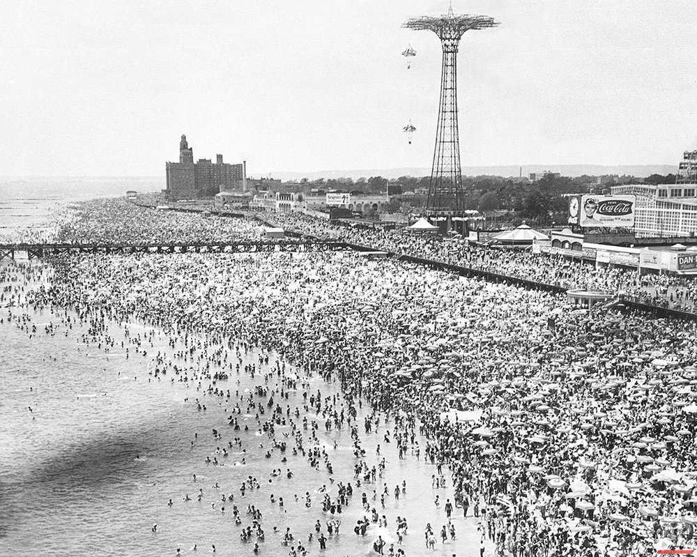 This aerial view shows sunbathers and swimmers at Coney Island in Brooklyn, N.Y., on Independence Day, July 4, 1961.  (AP Photo)