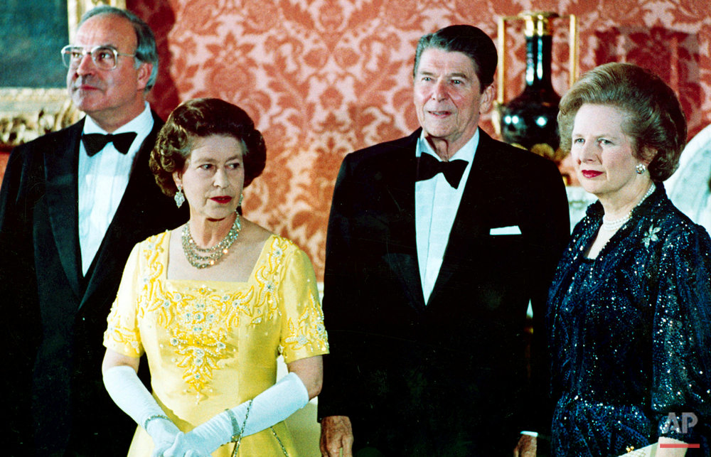 In a June 10, 1984 photo, Britain's Queen Elizabeth II, second left, stands with, West German Chancellor Helmut Kohl, left, U.S. President Ronald Reagan, second right, and Britain's Prime Minister Margaret Thatcher at London's Buckingham Palace, prior to a dinner for summit leaders. Thatchers former spokesman, Tim Bell, said that the former British Prime Minister Margaret Thatcher died Monday morning, April 8, 2013, of a stroke. She was 87. (AP Photo)