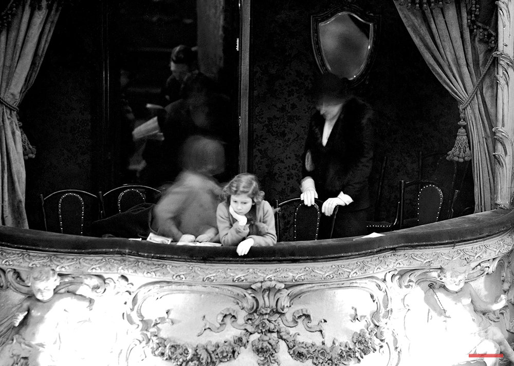 "Princess Elizabeth is seen in the Duchess's box at the ""Dick Whittington"" pantomime at the Lyceum Theater, Feb. 6, 1935. Princess Elizabeth and her little sister Princess Margaret Rose went with their mother Elizabeth, the Duchess of York, to the pantomime. (AP Photo)"