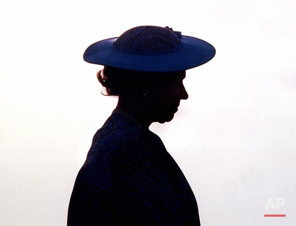 Britain's Queen Elizabeth II silhouetted during welcoming ceremonies at the airport in Barbados around March 8, 1989. (AP Photo/Peter Bregg)