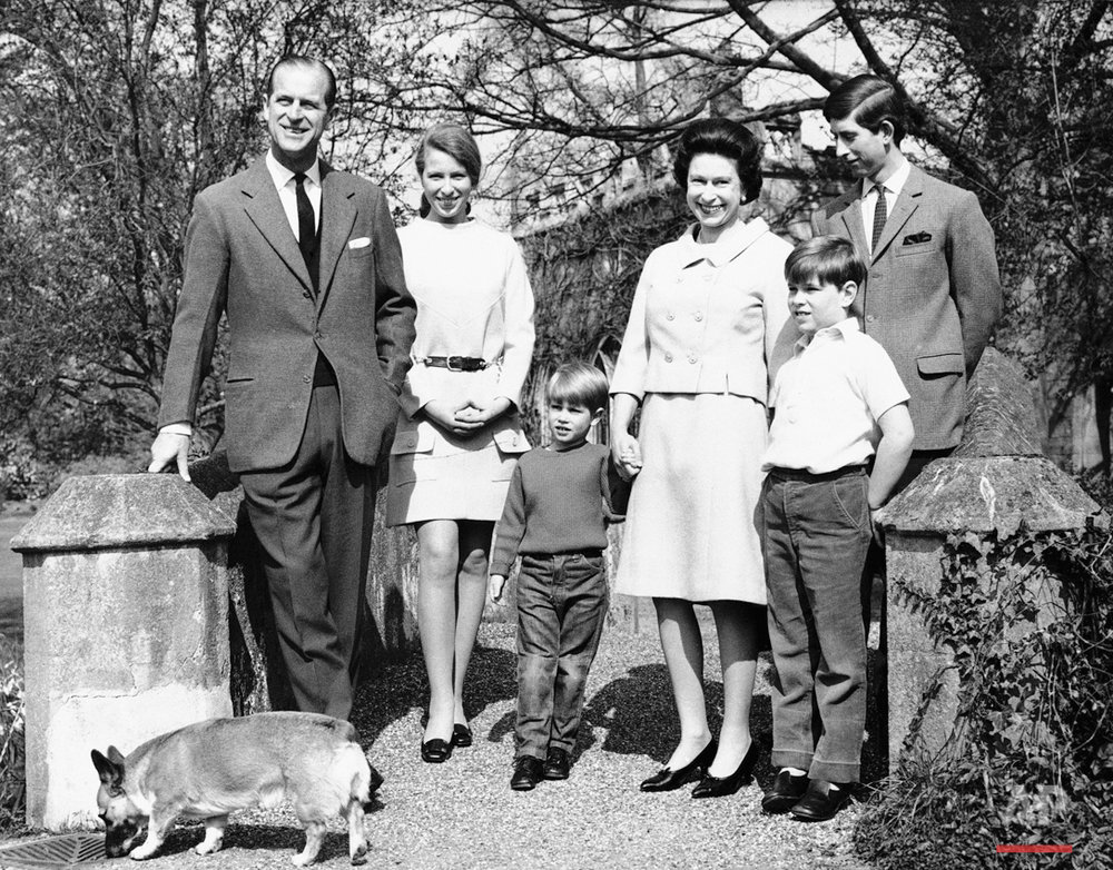 Queen Elizabeth II, who will celebrate her 42nd birthday, April 21, 1968, poses with her family at Frogmore, Windsor, England. From left, are: the Duke of Edinburgh, 46; Princess Anne, 17; Prince Edward, 4; the Queen; Prince Andrew, 8; and Prince Charles, the Prince of Wales, 19. Dog is family?s pet Corgi. (AP Photo)