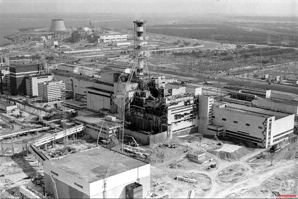 In this 1986 aerial view of the Chernobyl nuclear plant in Chernobyl, Ukraine shows damage from an explosion and fire in reactor four on April 26, 1986 that sent large amounts of radioactive material into the atmosphere. Only three Tass photographers were allowed in -- Volodymyr Repik, Igor Kostin and Valery Zufarov. Two later died of radiation-related illnesses, and Kostin suffered from the effects for decades before dying in a car accident in 2015. (AP Photo/Volodymyr Repik)