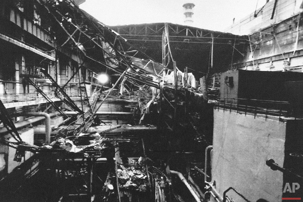 This Friday, Oct. 13, 1991 photo shows part of the collapsed roof at the Chernobyl, Ukraine nuclear power plant during a media tour of the facility, Ukraine. (AP Photo/Efrem Lukatsky)