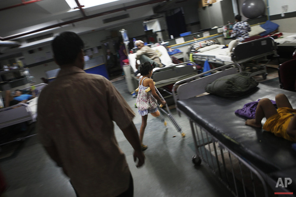 In this July 6, 2015 photo, Nepal earthquake survivor Nirmala Pariyar, 8, practices using her crutches to move around at the Bir Trauma Center in Kathmandu, Nepal. Nirmala lost one leg in Nepal's massive April 25, 2015 earthquake that killed nearly 9,000 people and left more than 22,000 injured. (AP Photo/Niranjan Shrestha)