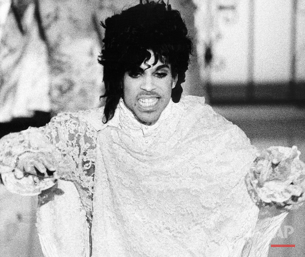 "Rock star Prince is shown during his performance onstage during the telecast of the Grammy Awards, Feb. 27, 1985 in Los Angeles. He won or shared three awards, including Best Rock Performance by a Duo or Group With Vocals, with his band Revolution, for ""Purple Rain""; Best Album of Original Score for TV or Movies, ""Purple Rain""; and Prince took Writing Rhythm and Blues honors for ""I Feel For You,"" recorded by Chaka Khan. (AP Photo/Liu Heung Shing)"