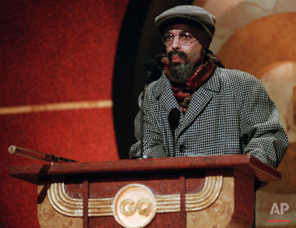 The Artist, formerly known as Prince, speaks at GQ magazine's third annual Men of the Year Awards in New York on Wednesday, Oct. 21, 1998. The Artist presented comedian Chris Rock with GQ's Television Comedy award. (AP Photo/Mitch Jacobson)
