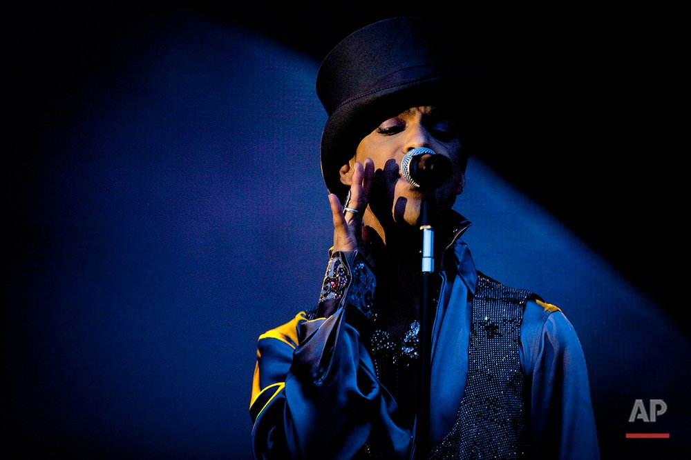 In this Saturday evening, Aug. 6 2011 photo American singer and songwriter Prince performs on the Isle of Amager in Copenhagen, Denmark. The concert was the first of two and it was interupted by heavy rain. (AP Photo/Polfoto/Jakob Joergensen)