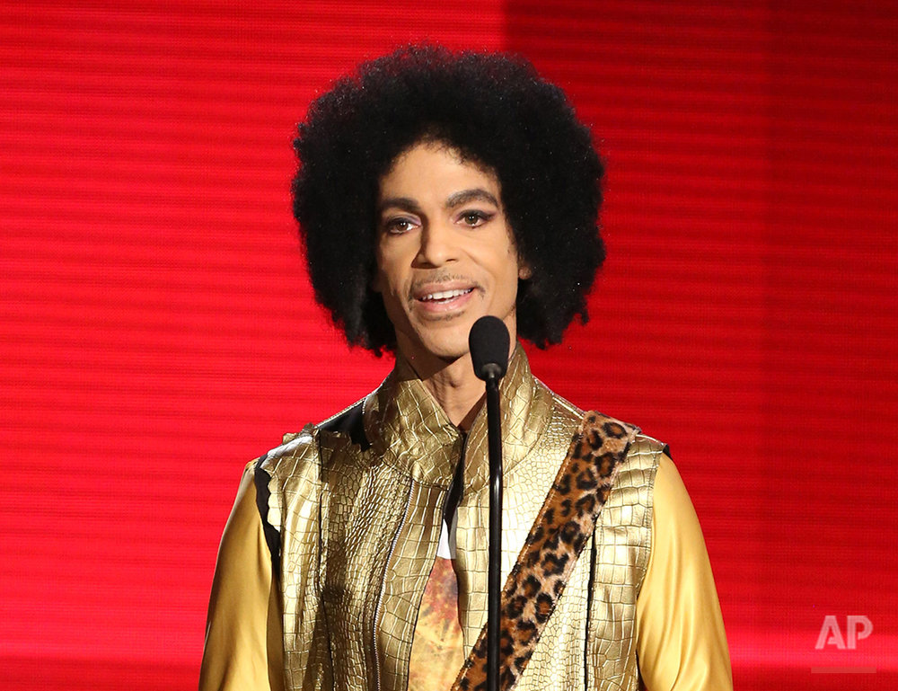 "In this Nov. 22, 2015 photo, Prince presents the award for favorite album - soul/R&B at the American Music Awards in Los Angeles. Prince, widely acclaimed as one of the most inventive and influential musicians of his era with hits including ""Little Red Corvette,"" ''Let's Go Crazy"" and ""When Doves Cry,"" was found dead at his home on Thursday, April 21, 2016, in suburban Minneapolis, according to his publicist. He was 57. (Photo by Matt Sayles/Invision/AP)"