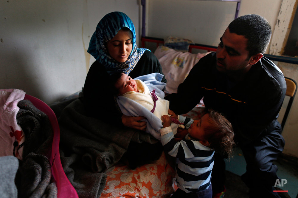 APTOPIX Serbia Migrants Baby Merkel