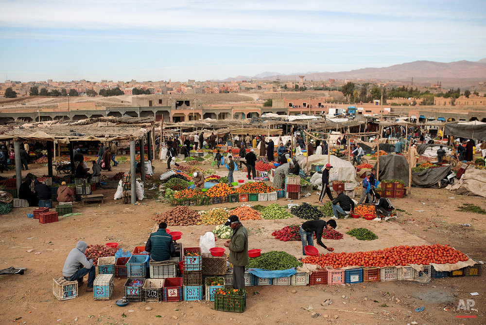 In this Wednesday, Feb. 3, 2016 photo, Amazigh villagers shop for fruits and vegetables at a weekly local market in Kalaat M'Gouna, in Ouarzazate, Morocco. Across North Africa, the Berbers number about 50 million. At least 15 million Moroccans are Amazigh, divided into different groups according to their dialects. While they speak the native Amazigh language of Tamazight, which has a large number of dialects and recently gained recognition as an official language in Morocco, many have adopted Arabic as part of a long process of Arabization and Islamization. (AP Photo/Mosa'ab Elshamy)