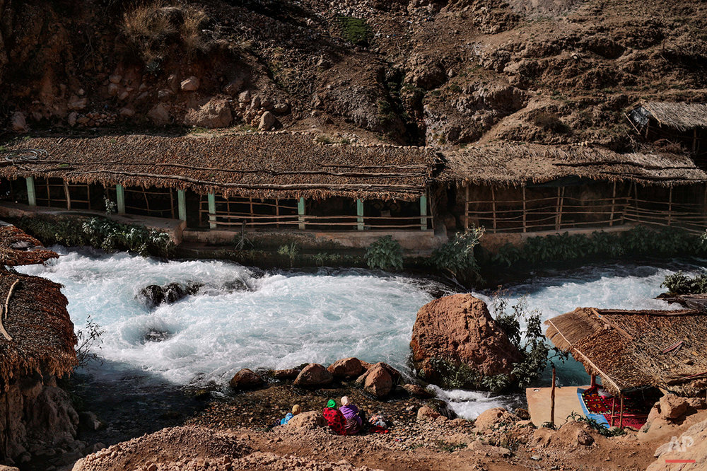 "In this Saturday, Feb. 6, 2016 photo, Amazigh women wash laundry by the Oum Rabia water springs, in Khénifra, Morocco. Indomitable and proud, they call themselves the Amazigh, which is believed to mean ""free people"" or ""noble men,"" and trace their origins as an indigenous people in western North Africa to at least 10,000 B.C. (AP Photo/Mosa'ab Elshamy)"