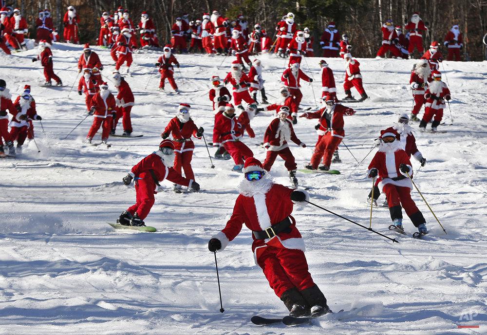 APTOPIX Skiing Santas