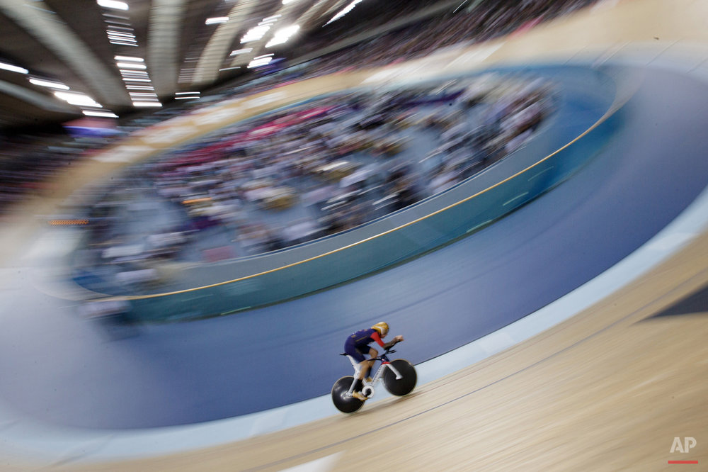 In this June 7, 2015 photo, Britain's Sir Bradley Wiggins rides on his way to breaking the UCI Hour Record at the Olympic Velodrome in Lee Valley Velopark, London. Former Tour de France winner Bradley Wiggins broke cycling's prestigious hour record, covering 54.526 kilometers (33.88 miles) in 60 minutes. (AP Photo/Tim Ireland)