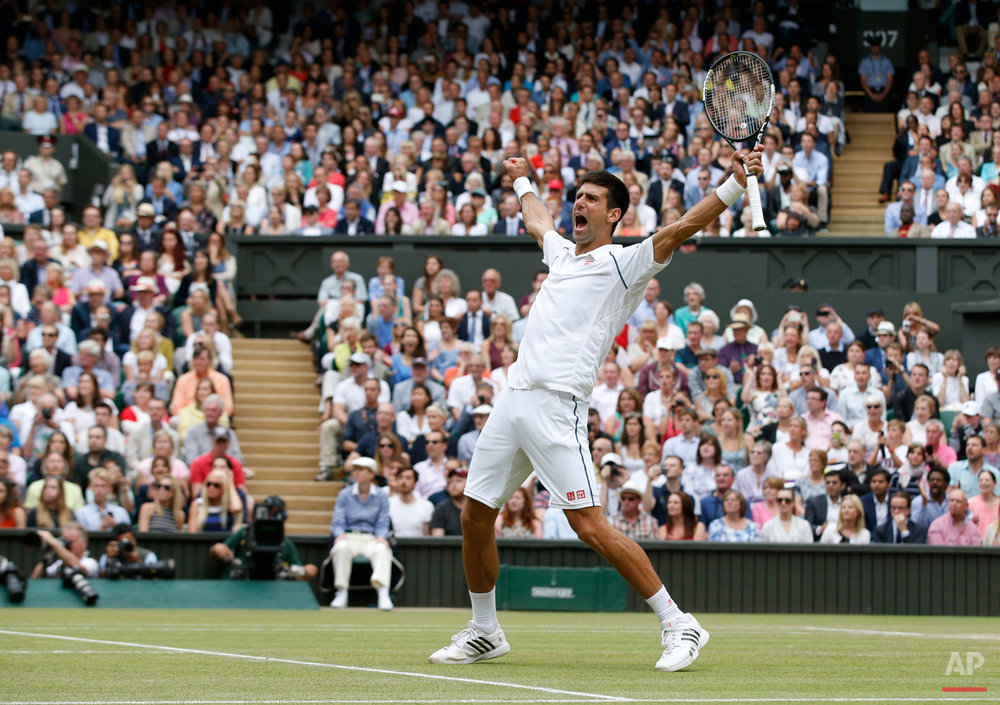 In this July 12, 2015 photo, Novak Djokovic of Serbia celebrates winning the men's singles final against Roger Federer of Switzerland at the All England Lawn Tennis Championships in Wimbledon, London. Djokovic won the match 7-6, 6-7, 6-4, 6-3. (AP Photo/Alastair Grant)