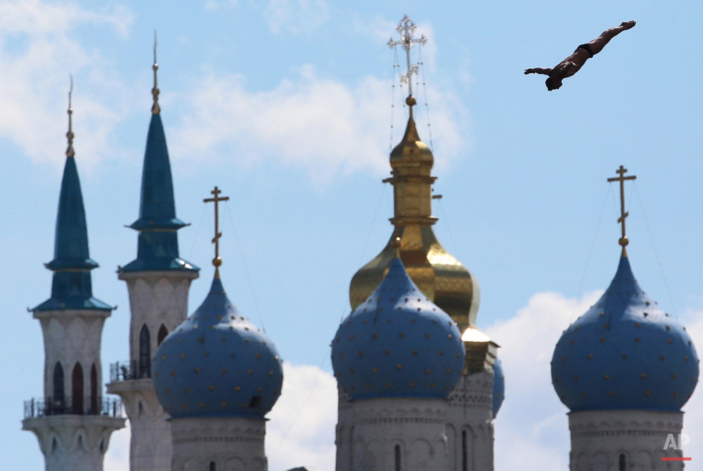 In this Aug. 3, 2015 photo Artem Silchenko of Russia competes during the men's 27 meter high dive competition at the Swimming World Championships in Kazan, Russia. (AP Photo/Denis Tyrin)