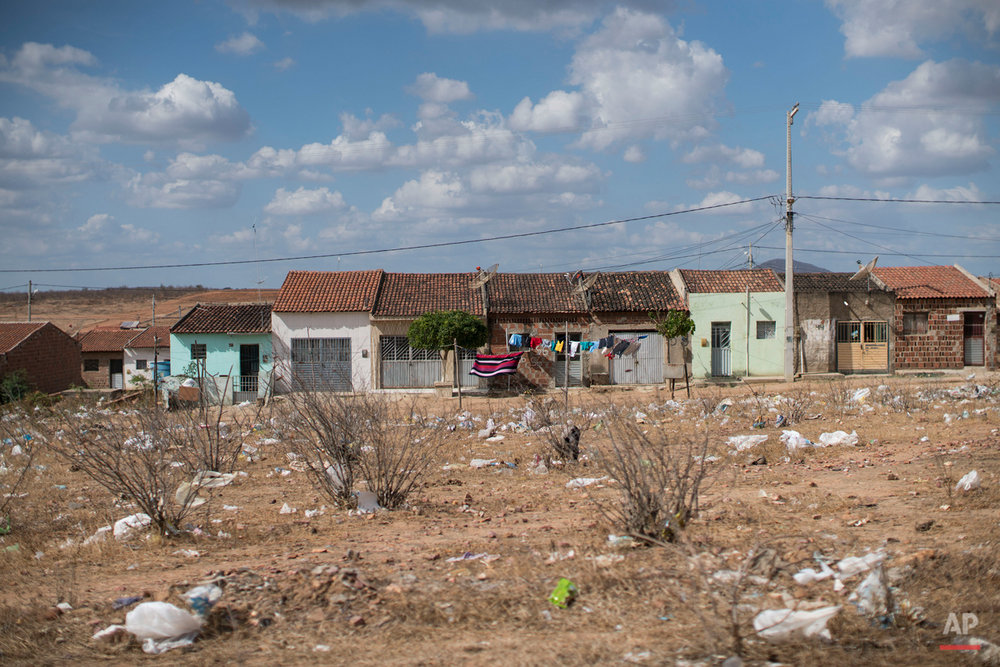 In this Dec. 23, 2015 photo, plastic bags and trash lay on the ground in Santa Cruz do Capibaribe, where many cases of Zika where reported in Pernambuco state, Brazil, Wednesday. The Zika virus, first detected about 40 years ago in Uganda, has long seen as a less-painful cousin to dengue and chikunguya, which are spread by the same Aedes mosquito. (AP Photo/Felipe Dana)