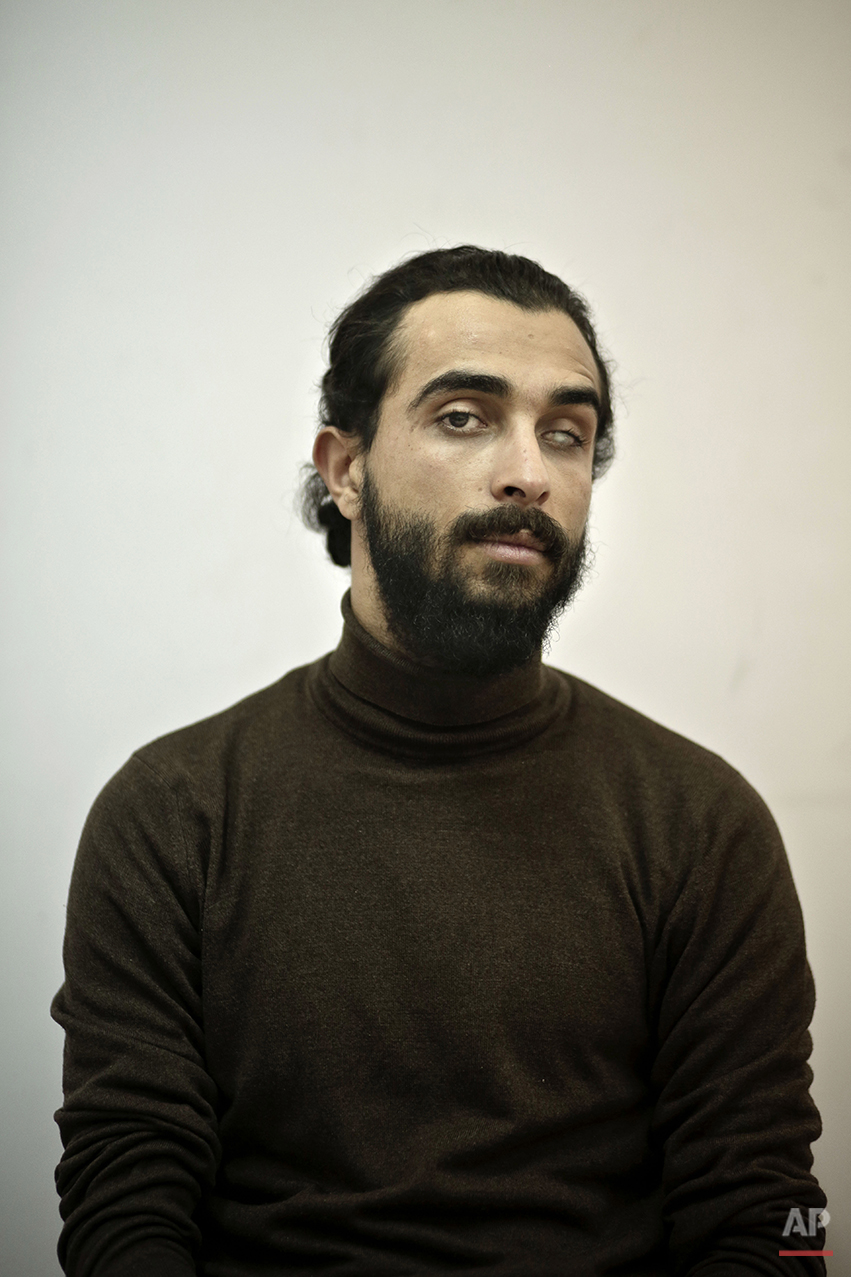 "Ahmed El-Sheikh, a 25-year old Egyptian freelance investigative journalist, poses for a photograph inside his home, during the fifth anniversary of the 2011 uprising, in Cairo, Egypt, Monday, Jan. 25, 2016. ""Why don't we go down today? Because if we do we will either be arrested, tortured, or killed by the law. The political figures who owe their fame to activists have deserted us. The media does not support us at all,"" he says. El-Sheikh lost his eye on Jan. 28, 2011 from a pellet during clashes in Alexandria. (AP Photo/Nariman El-Mofty)"