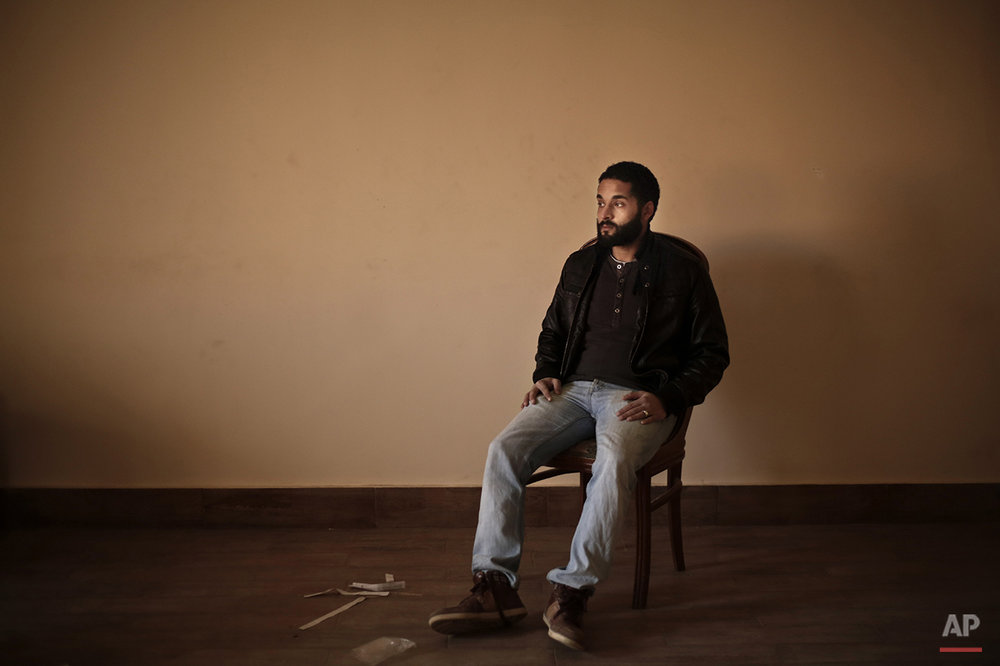 "Abdullah Dnewaor, a 28-year old Egyptian filmmaker, poses for a photograph in his home, during the fifth anniversary of the 2011 uprising, in Cairo, Egypt, Monday, Jan. 25, 2016. ""The Jan. 25 revolution was purer than what followed. Every year we regret the outcome. This is not what we wanted. We dreamed of a better Egypt but we were also very naive and did not understand fully what was going on. Egypt is home to the people in power and we are the guests. I want to leave the country because I do not see a bright future of my daughter,"" says Dnewaor. (AP Photo/Nariman El-Mofty)"