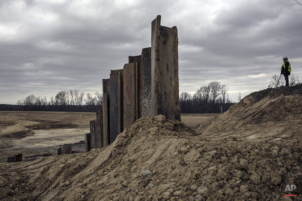 In this photo taken Dec. 18, 2015, the beginnings of the inlet structure for the Genesee County water treatment plant is seen in Oregon Township, Mich. When completed, the plant will receive water directly from Lake Huron via the Karegnondi Water Authority pipeline. (Sean Proctor/The Flint Journal-MLive.com via AP) 