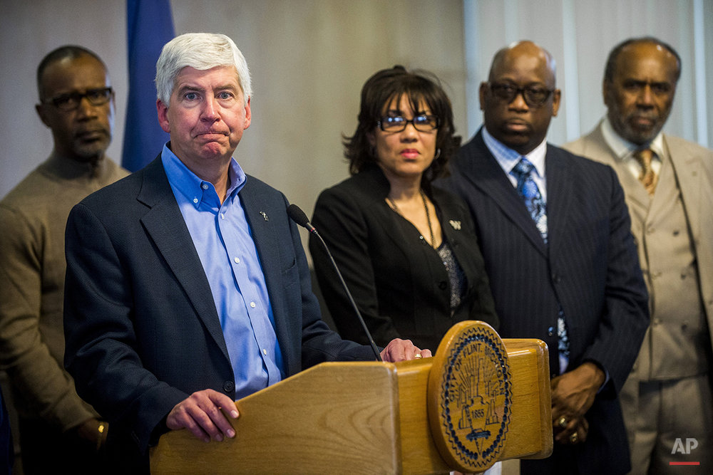 Michigan Gov. Rick Snyder speaks during a news conference in Flint, Mich., Monday, Jan. 11, 2016. Snyder pledged Monday that officials would make contact with every household in Flint to check whether residents have bottled water and a filter and want to be tested for lead exposure while his embattled administration works on a long-term solution to the city's water crisis. (Jake May/The Flint Journal-MLive.com via AP) 
