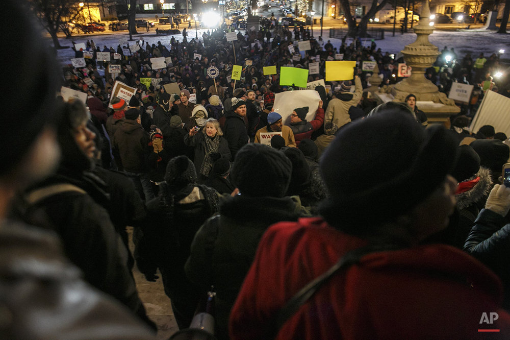 Protestors rally outside of the state Capitol during Michigan Gov. Rick Snyder's State of the State address on Tuesday, Jan. 19, 2016, in Lansing, Mich. With the water crisis gripping Flint threatening to overshadow nearly everything else he has accomplished, the Republican governor again pledged a fix Tuesday night during his annual State of the State speech. (Sean Proctor/The Flint Journal-MLive.com via AP) 