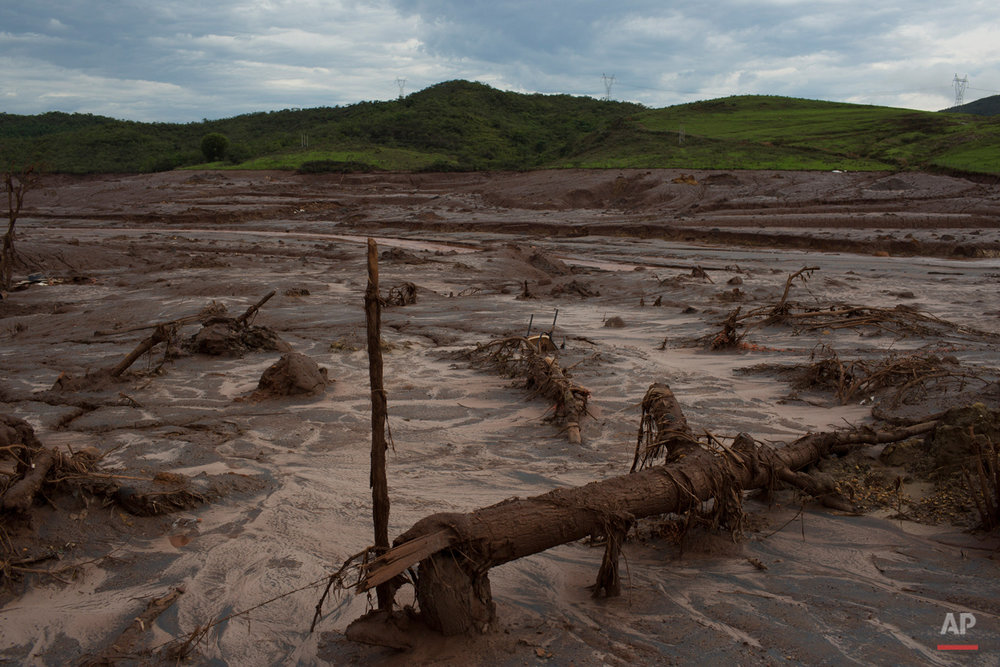 This Nov. 23, 2015 photo shows debris awash in mud in Bento Rodrigues, Brazil. After obliterating several towns, the tide of mud and debris surged forward, blanketing a wide swath of land and cascading into the Doce River. (AP Photo/Leo Correa)