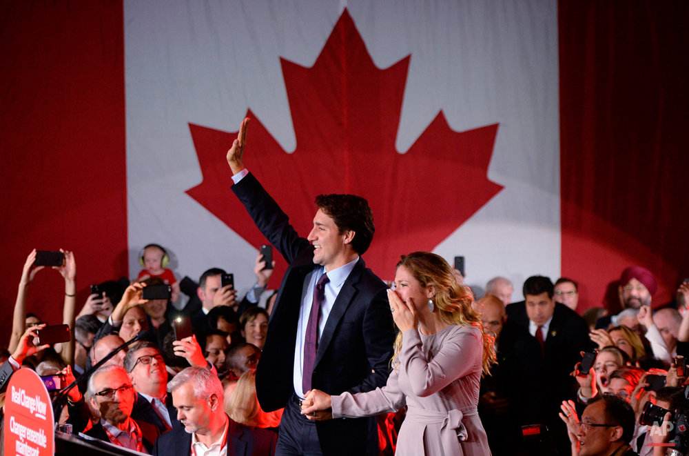 Liberal leader Justin Trudeau makes his way to the stage with wife Sophie Gregoire at the Liberal party headquarters in Montreal, Tuesday, Oct. 20, 2015. Trudeau, the son of late Prime Minister Pierre Trudeau, became CanadaÌs new prime minister after beating Conservative Stephen Harper. (Sean Kilpatrick/The Canadian Press via AP)