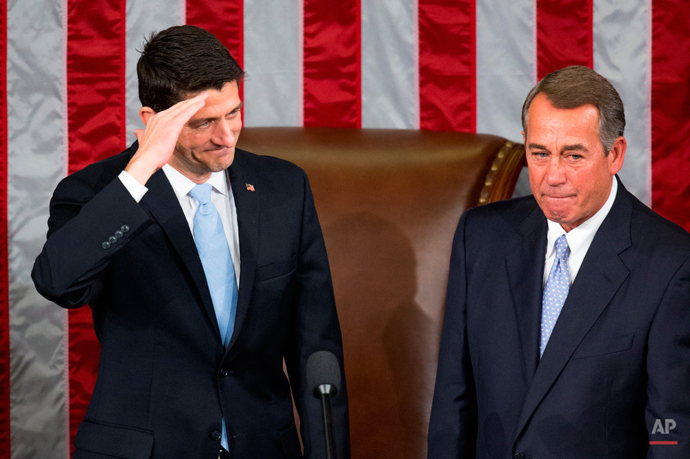 House Speaker John Boehner stands with his successor Rep. Paul Ryan, R-Wis., left, in the House Chamber on Capitol Hill in Washington, Thursday, Oct. 29, 2015. Republicans rallied behind Ryan to elect him the House's 54th speaker as a splintered GOP turned to the youthful but battle-tested lawmaker to mend its self-inflicted wounds and craft a conservative message to woo voters in next year's elections. (AP Photo/Andrew Harnik)