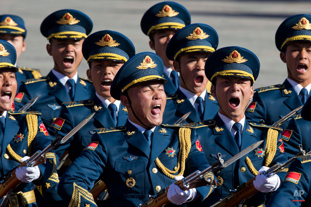 Members of a Chinese honor guard shout as they march past during a welcome ceremony for German Chancellor Angela Merkel held outside the Great Hall of the People in Beijing, China, Thursday, Oct. 29, 2015. (AP Photo/Ng Han Guan)