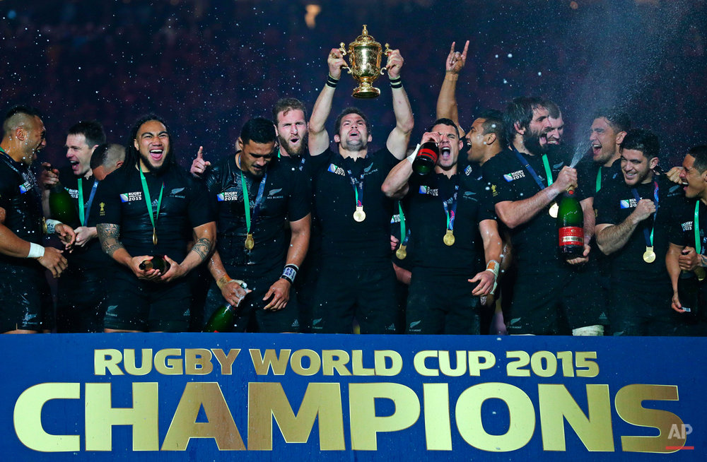 New Zealand's captain Richie McCaw holds the trophy aloft after the Rugby World Cup final between New Zealand and Australia at Twickenham Stadium in London, Saturday, Oct. 31, 2015. The All Blacks won 34-17. (AP Photo/Tim Ireland)