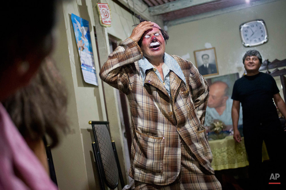 "In this Feb. 7, 2015, photo, veteran clown Ricardo Farfan, popularly known as ""Pitito,"" performs during his 91st birthday party at his home in Lima, Peru. Farfan said he most liked being a clown while performing a variety of acts at his father's circus, which he took over in the 70s, and that a clown has to be humble, speak from the heart and give joy to all ages. He added his disappointment with some clowns today who are vulgar with their audience. (AP Photo/Esteban Felix)"