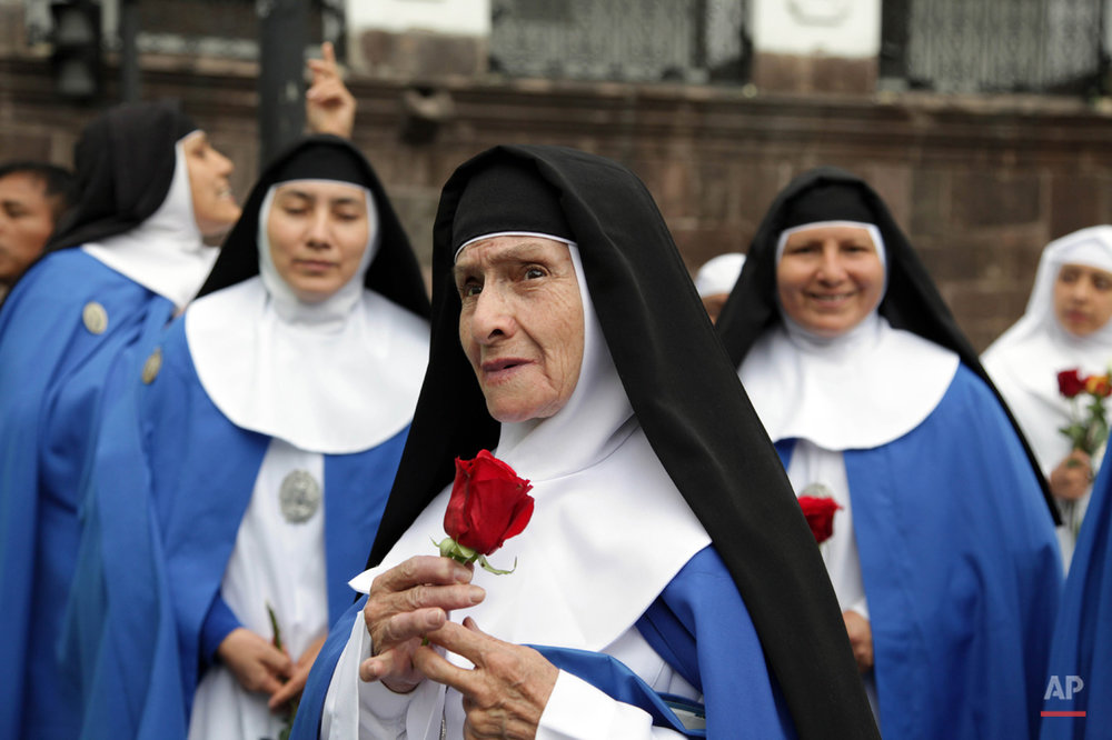 In this July 6, 2015, photo, nuns arrive at Independence square, invited to attend the meeting of Pope Francis and Ecuador's President Rafael Correa in Quito, Ecuador. After a Mass in the port city of Guayaquil where hundreds of thousands listened to Pope Francis while standing in the hot sun, he will return to the Capital of Quito. Francis is making his first visit as pope to his Spanish-speaking neighborhood. He'll travel to three South American nations, Ecuador, Bolivia and Paraguay. (AP Photo/Ana Buitron)
