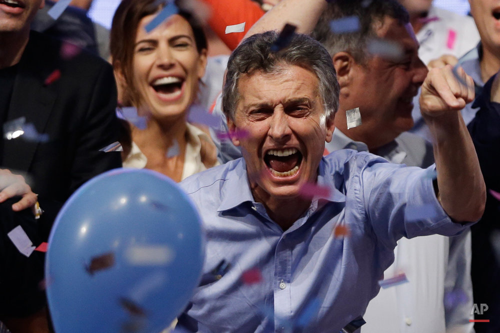 In this Nov. 22, 2015, photo, opposition presidential candidate Mauricio Macri and his wife Juliana Awada, back left, celebrate after winning a runoff presidential election in Buenos Aires, Argentina. Macri won Argentina's historic runoff election against ruling party candidate Daniel Scioli, putting an end to the era of President Cristina Fernandez, who along with her late husband dominated Argentine politics for 12 years. (AP Photo/Ricardo Mazalan)
