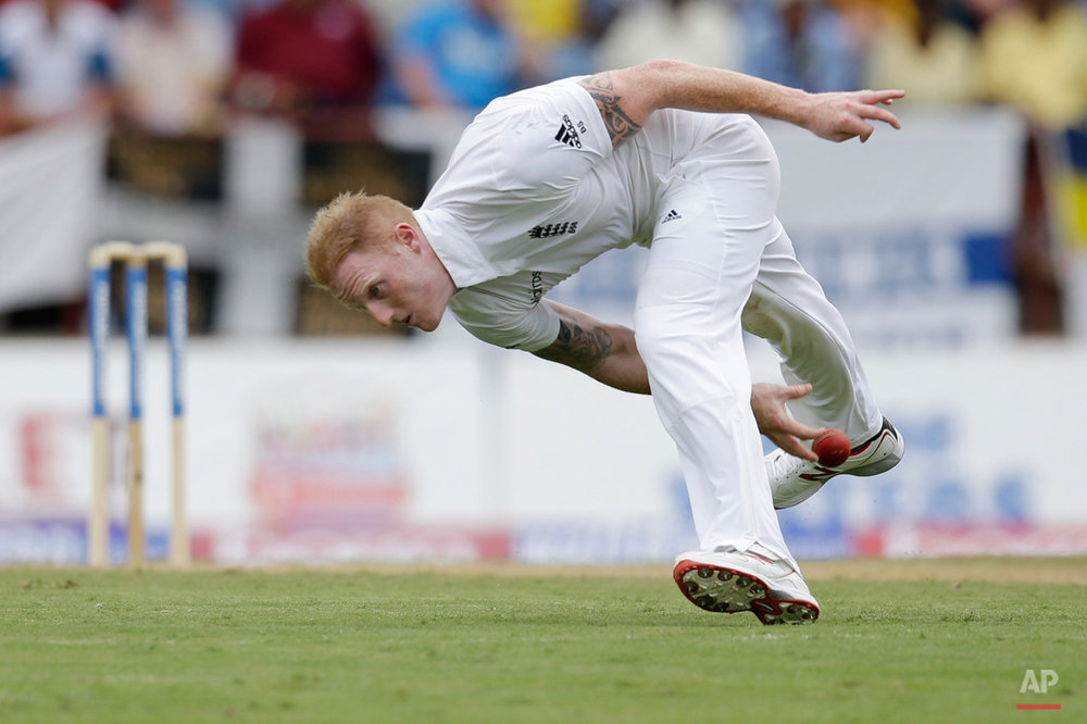 In this April 21, 2015, photo, England's bowler Ben Stokes fields a shot played by Marlon Samuels during day one of their second Test match at the National Stadium in St. George's, Grenada. (AP Photo/Ricardo Mazalan)