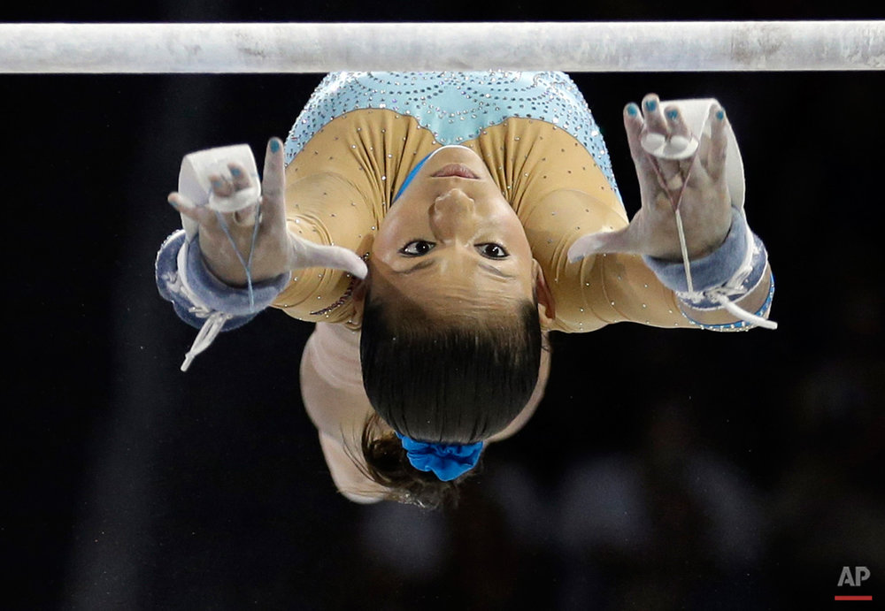 In this July 14, 2015, photo, Venezuela's Jessica Lopez performs during the women's artistic gymnastics uneven bars competition in the Pan Am Games in Toronto. Lopez won the silver medal in the event. (AP Photo/Gregory Bull)