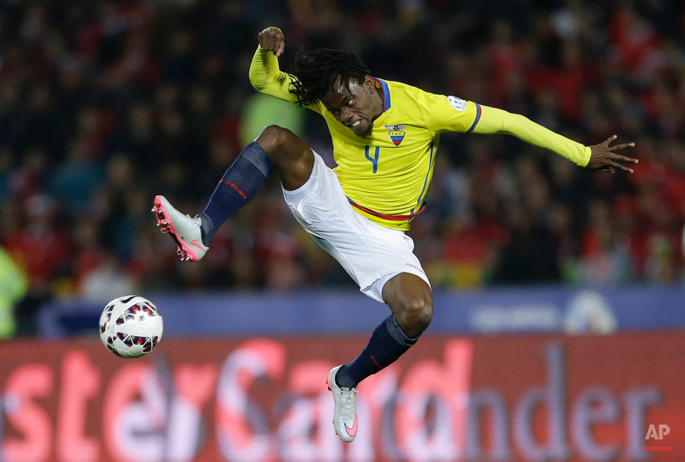 In this June 11, 2015, photo, Ecuador's Juan Carlos Paredes kicks the ball during a Copa America Group 1 soccer match against Chile at the National Stadium in Santiago, Chile. (AP Photo/Ricardo Mazalan)
