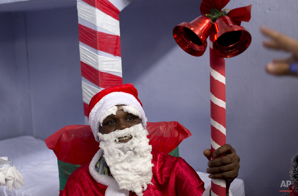 Carina Barbosa performs as Santa Claus inside the Nelson Hungria prison in Rio de Janeiro, Brazil, Thursday, Dec. 10, 2015. Barbosa, a 29-year-old who's serving time for drug trafficking, was one of more than 500 inmates ringing in the holidays Thursday at Rio de Janeiro's Nelson Hungria prison with Passion plays and a cell decorating contest. (AP Photo/Silvia Izquierdo)