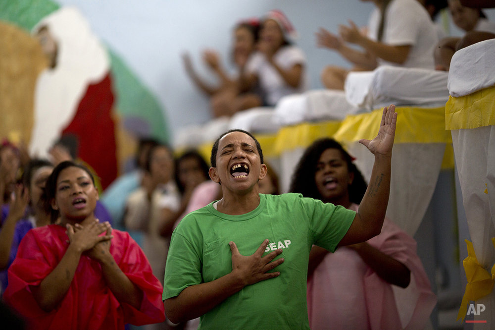 Prisoners perform during a Christmas decorating contest inside their pavillion at the Nelson Hungria prison in Rio de Janeiro, Brazil, Thursday, Dec. 10, 2015. Inmates, overwhelming black and mixed-race women who are serving time for offenses from burglary to homicide, spent weeks decking out the cell blocks with holiday decorations they made themselves from the objects they have access to behind bars. (AP Photo/Silvia Izquierdo)