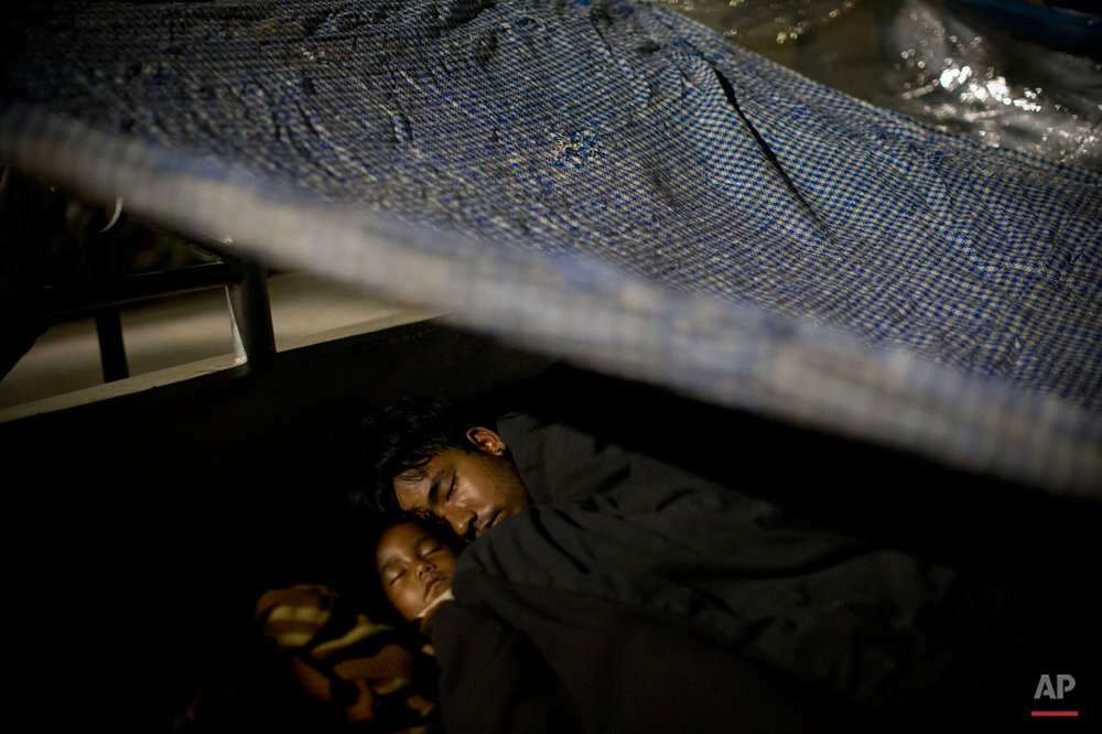 A Nepalese family sleeps sheltered by plastic sheets in an open space after an earthquake hit the region earlier in the day, in Kathmandu, Nepal, Tuesday, May 12, 2015. A new earthquake Tuesday spread more fear and misery in Nepal, which is still struggling to recover from a devastating quake nearly three weeks ago that left thousands dead. (AP Photo/Bernat Amangue)