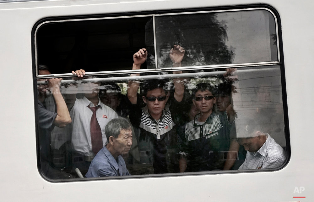 Commuters ride on a city trolley bus, Friday, Sept. 11, 2015 in Pyongyang, North Korea. The city trolley is one of the more common forms of public transportation among North Koreans living in Pyongyang. (AP Photo/Wong Maye-E)