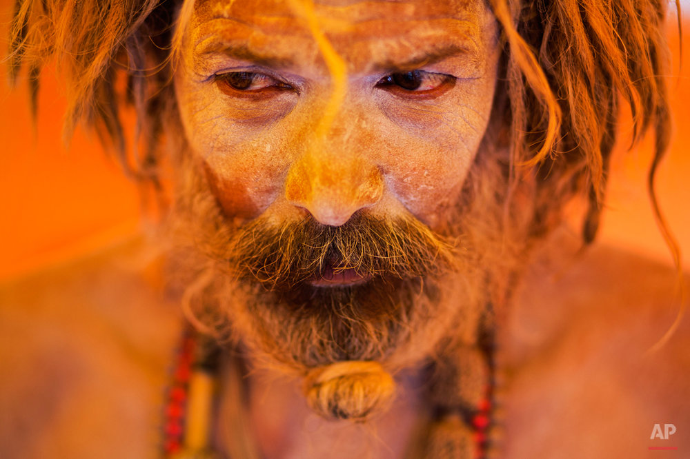 In this Aug. 27, 2015 photo, Naga sadhu, or naked Hindu holy man, pauses inside a tent during Kumbh Mela, or Pitcher festival, at Trimbakeshwar, India. Hindus believe taking a dip in the waters of a holy river during the festival will cleanse them of their sins. The festival is held four times every 12 years. (AP Photo/Bernat Armangue)