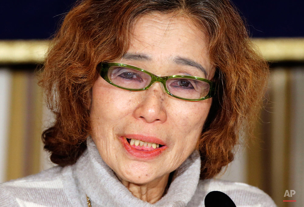 "Junko Ishido, mother of Japanese journalist Kenji Goto who was taken hostage by the Islamic State group, speaks during a press conference in Tokyo, Friday, Jan. 23, 2015. Ishido said she was astonished and angered to learn from her daughter-in-law that Goto had left less than two weeks after his child was born, in October, to go to Syria to try to rescue the other hostage, 42-year-old Haruna Yukawa. ""My son is not an enemy of the Islamic State,"" she said in a tearful appearance in Tokyo. (AP Photo/Koji Sasahara)"