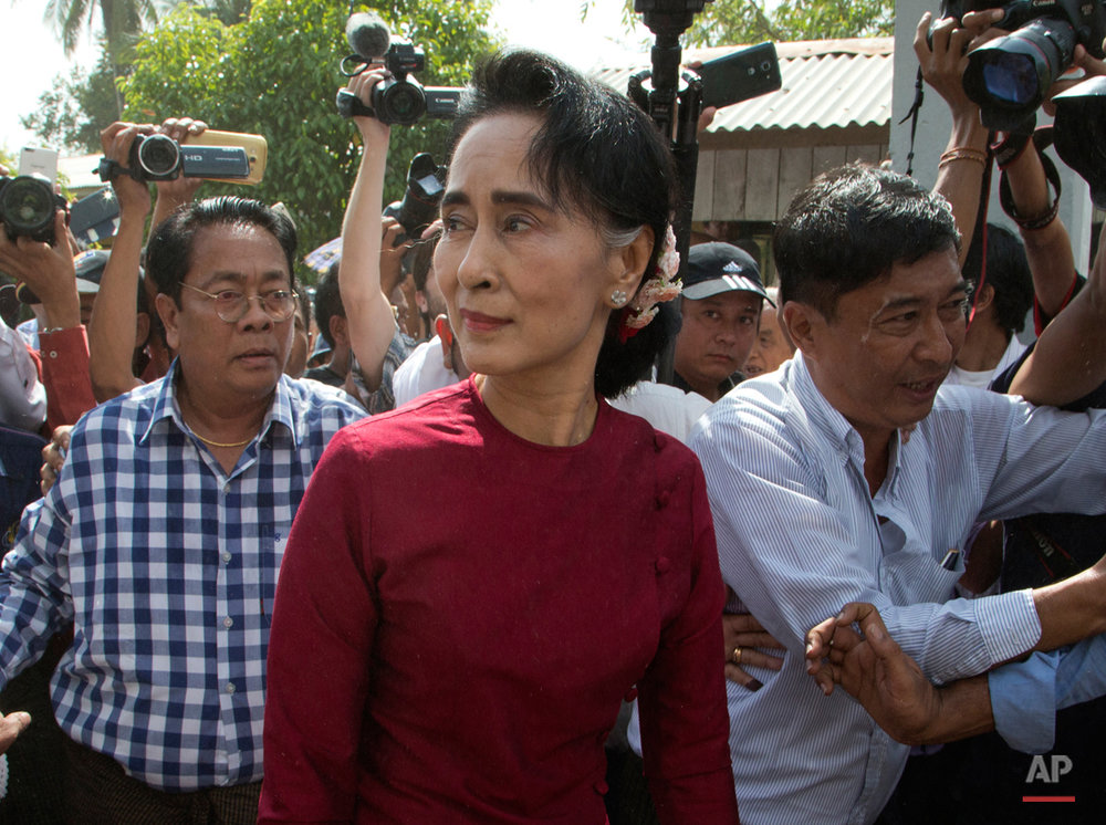 Leader of Myanmar's National League for Democracy party, Aung San Suu Kyi visits a polling station on the outskirts Yangon, Myanmar, Sunday, Nov. 8, 2015. Myanmar voted Sunday in historic elections that will test whether popular mandate will help loosen the military's longstanding hold on power even if opposition leader Suu Kyi's party secures a widely-expected victory. (AP Photo/Mark Baker)
