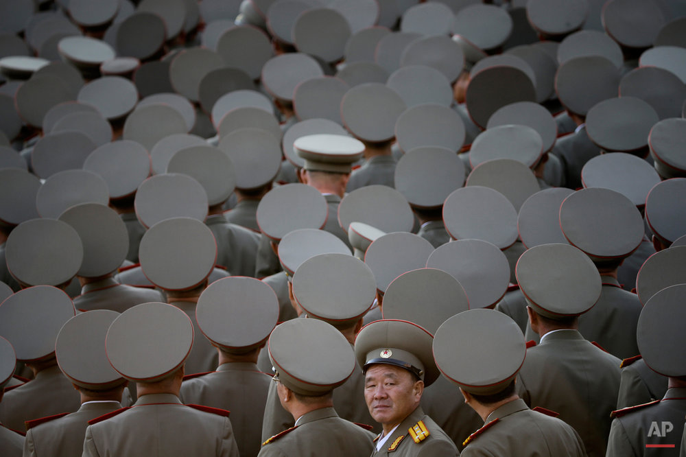 In this Oct. 10, 2015 photo, North Korean veterans gather before the start of a parade in Pyongyang, North Korea. North Korean leader Kim Jong Un declared Saturday that his country was ready to stand up to any threat posed by the United States as he spoke at a lavish military parade to mark the 70th anniversary of the North's ruling party and trumpet his third-generation leadership. (AP Photo/Maye-E Wong)