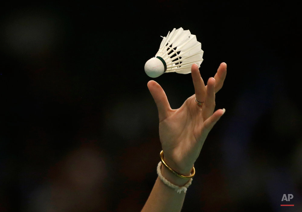 In this Thursday, June 4, 2015, photo, Ratchanok Intanon of Thailand serves against her compatriot Busanan Ongbumrungpan during their women's singles second round match at the Indonesia Open badminton tournament in Jakarta, Indonesia. (AP Photo/Dita Alangkara)