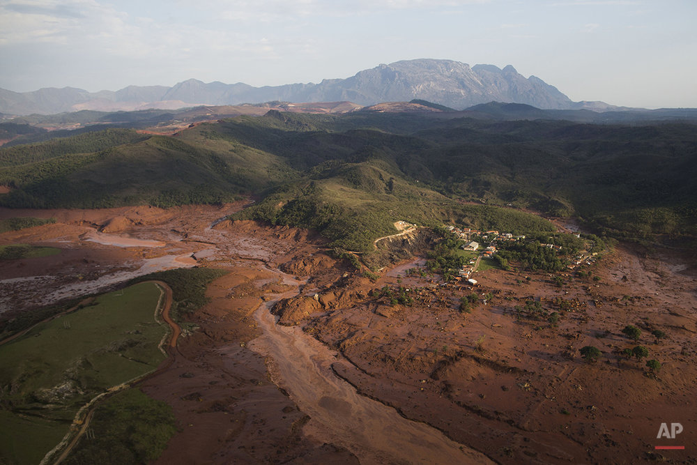 Aerial view of the debris and mud on Thursday, at the small town of Bento Rodrigues after a dam burst in Minas Gerais state, Brazil, Friday, Nov .6, 2015. (AP Photo/Felipe Dana)