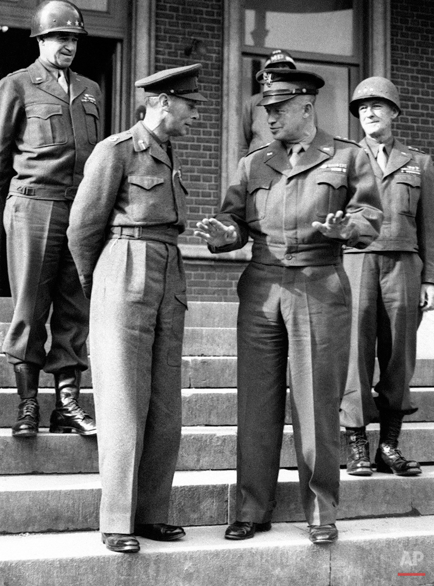 American General Dwight Eisenhower, right, relating an amusing incident to Britain's King George VI, on the steps of the U.S. headquarters during his visit to the American front in France on Oct. 16, 1944. On left back is General Omar Bradley, and right General Courtney Hodges. (AP Photo)