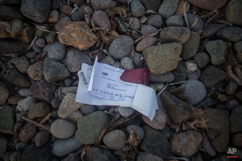 In this Sunday, Oct. 4, 2015 photo, a boarding card of a Baghdad-Istanbul flight remains left behind on a beach next to the town of Molyvos, on the northeastern Greek island of Lesbos. (AP Photo/Santi Palacios)