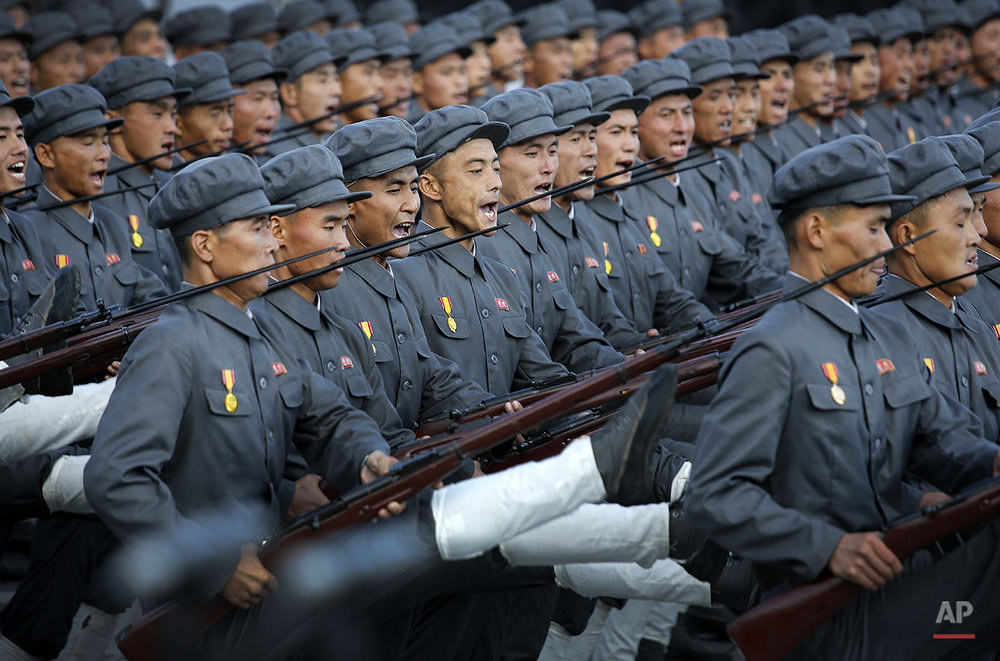 North Korean soldiers in historic uniforms march during a parade on the Kim Il Sung Square, Saturday, Oct. 10, 2015, in Pyongyang, North Korea. North Korean leader Kim Jong Un declared Saturday that his country was ready to stand up to any threat posed by the United States as he spoke at a lavish military parade to mark the 70th anniversary of the North's ruling party and trumpet his third-generation leadership.(AP Photo/Wong Maye-E)